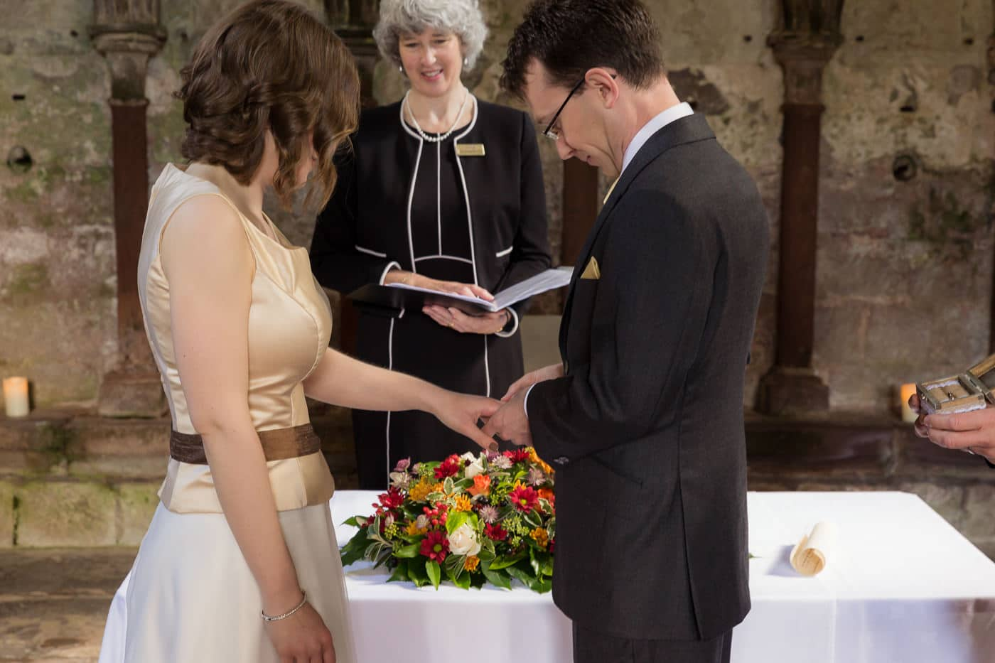 The bridal couple are exchanging rings
