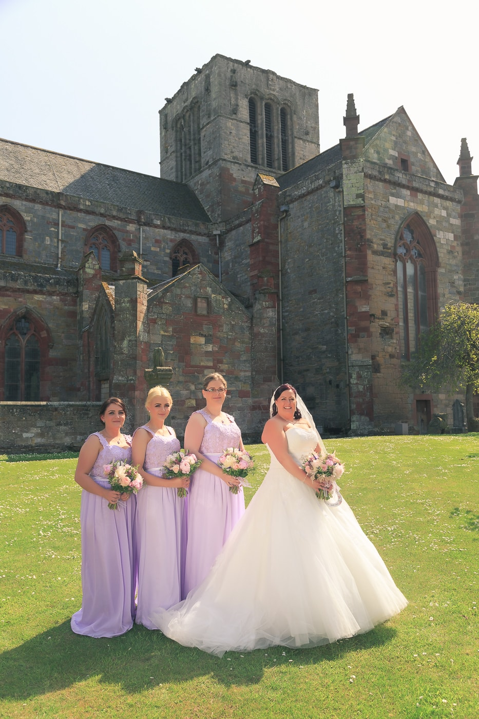 The bridal party in the church yard