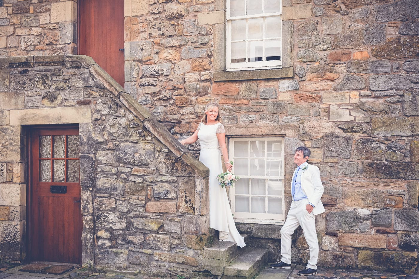 The bride and groom in the streets of St Andrews
