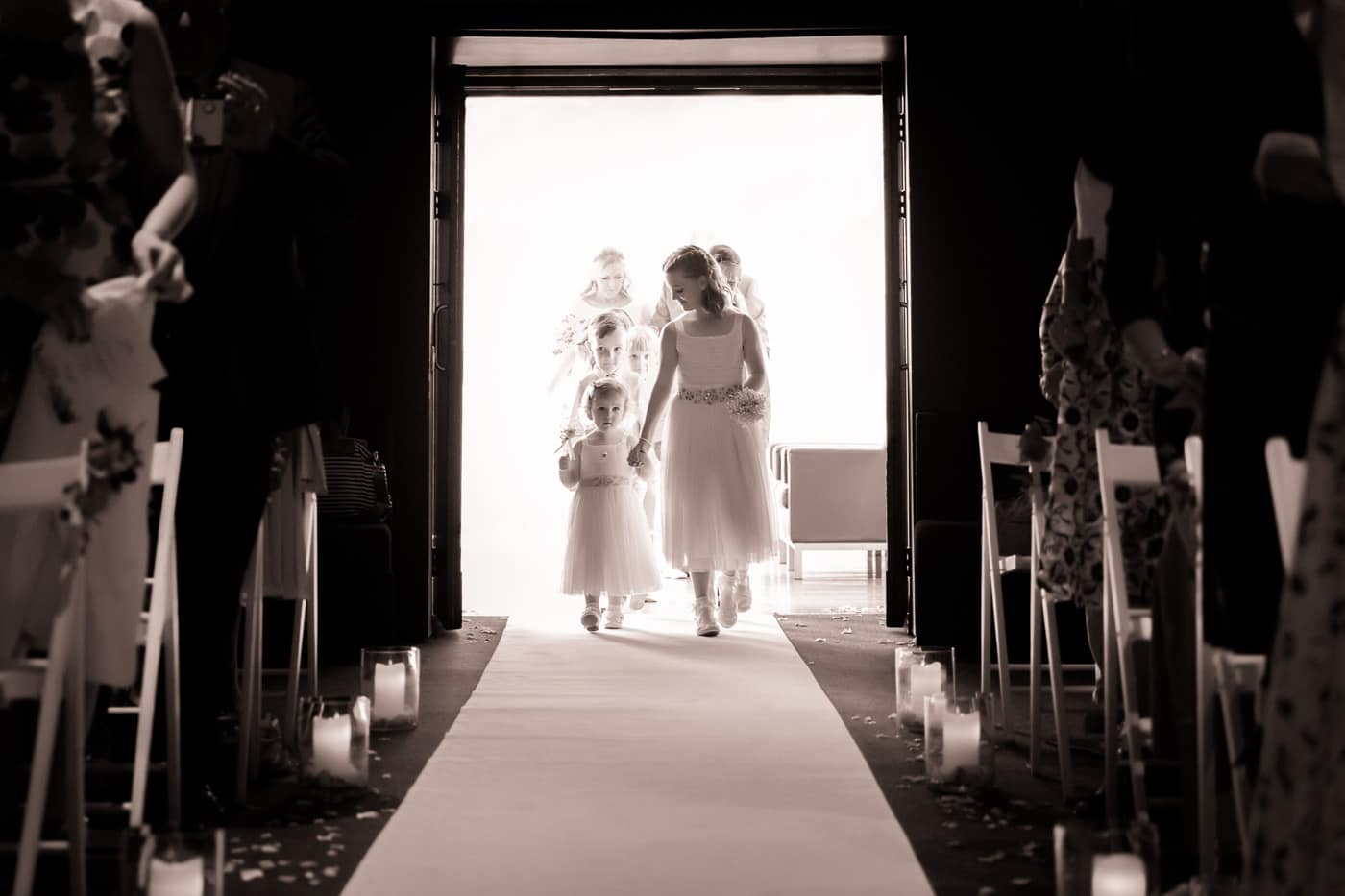 The flower girls walking down the isle