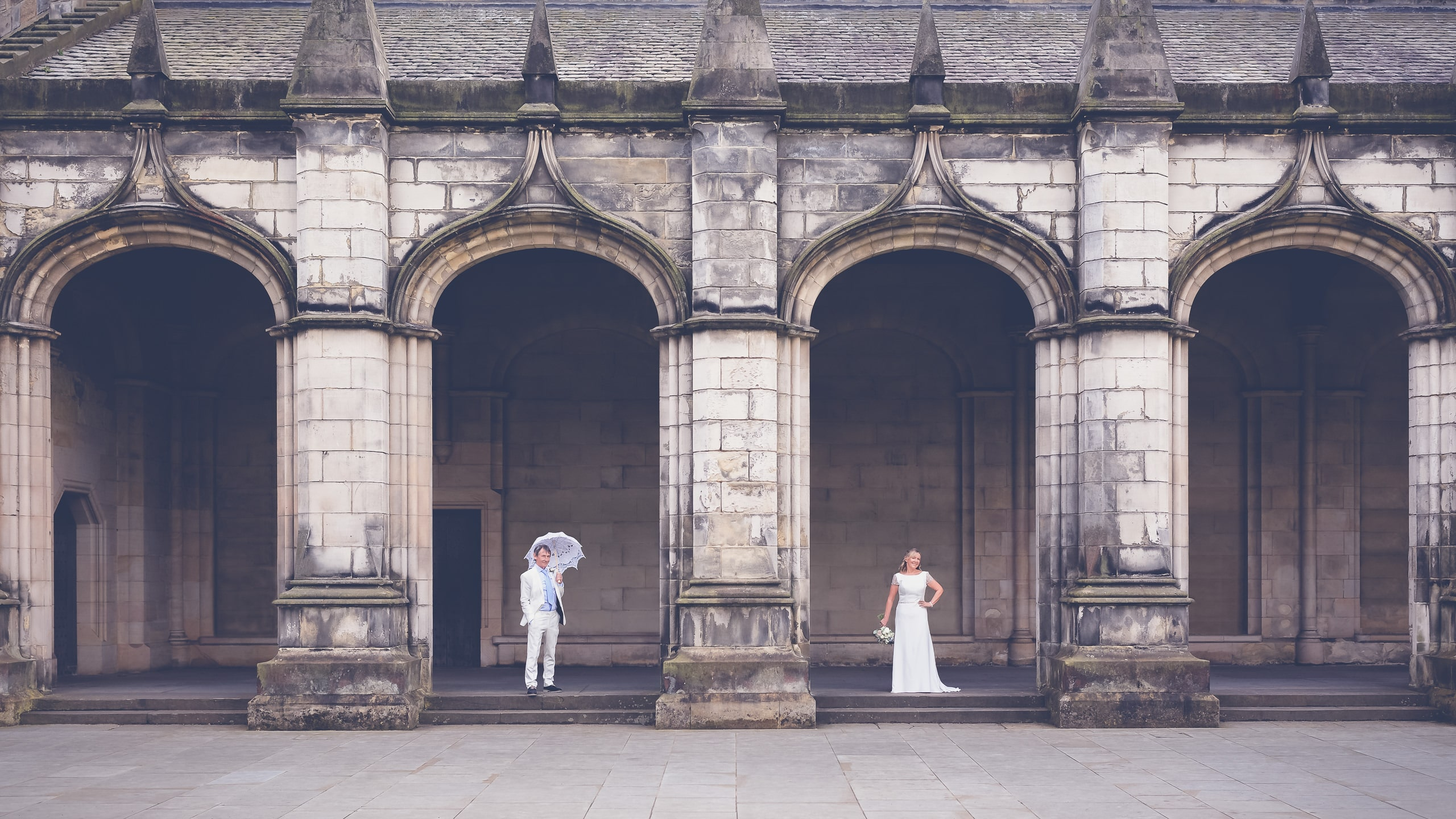 The bride and groom in St Andrews arches