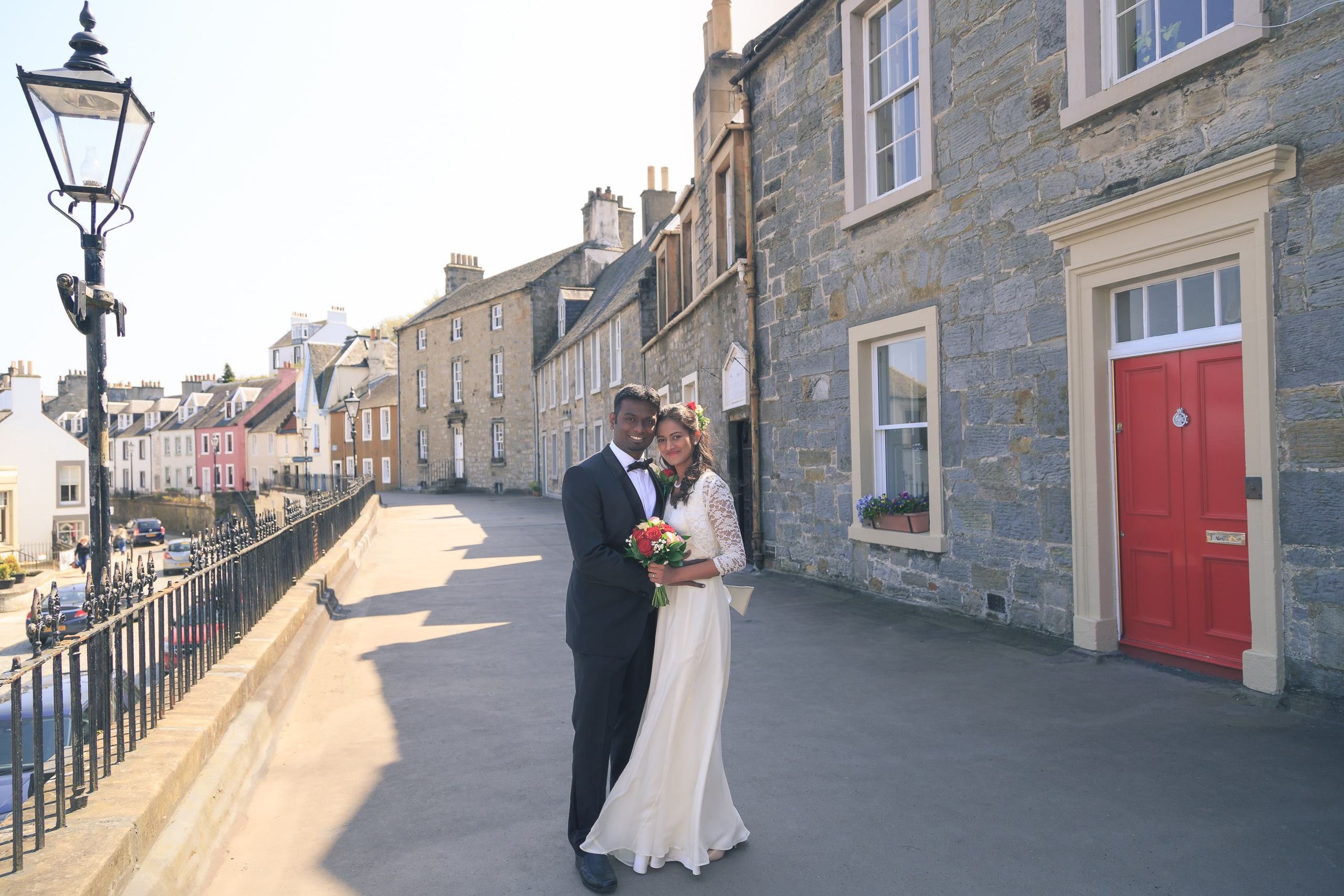 The bride and groom in the streets of South Queensferry