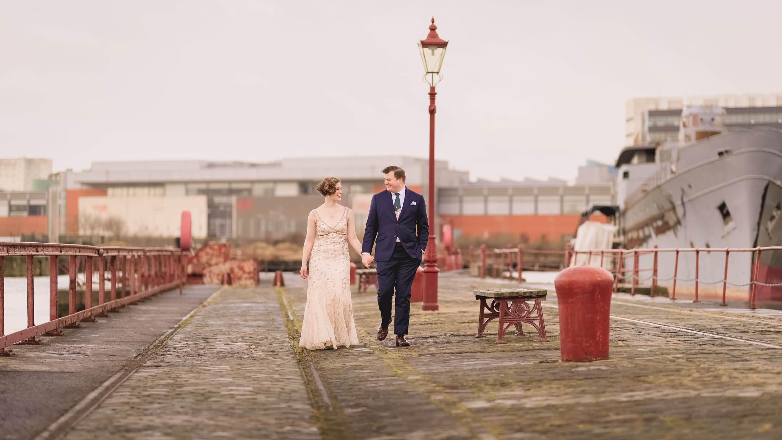 Bride and groom walking on Leith docks