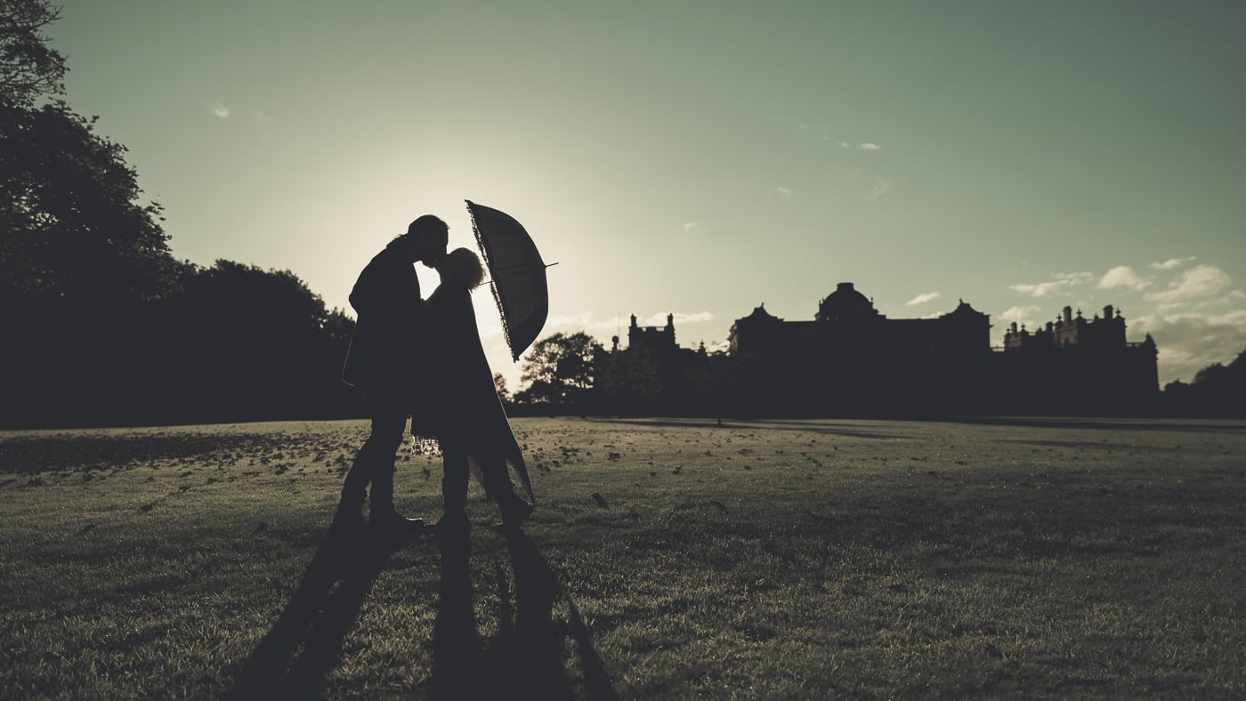 Silhouette of the couple kissing at sunset