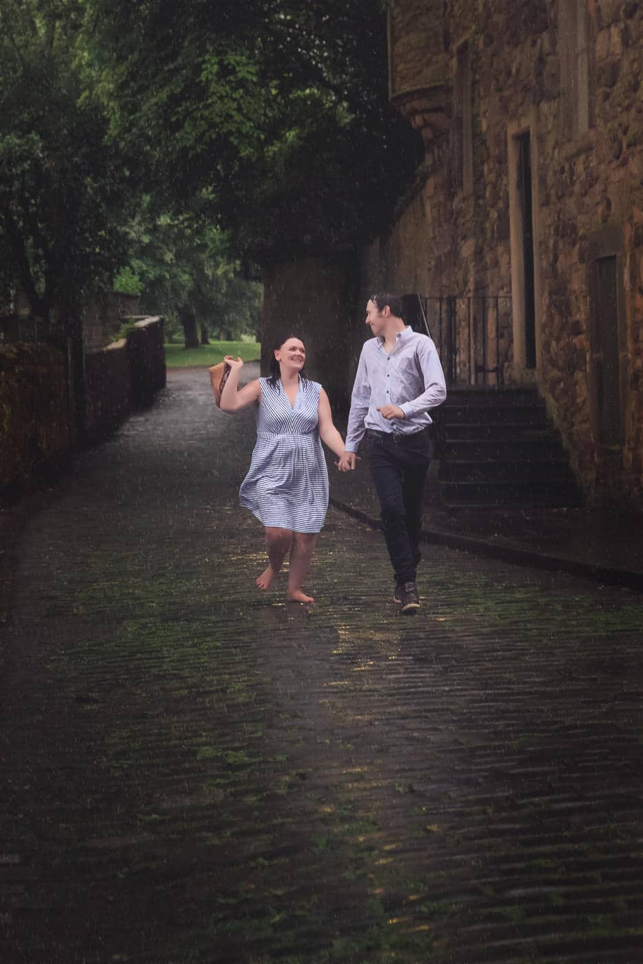 The couple is running in the rain
