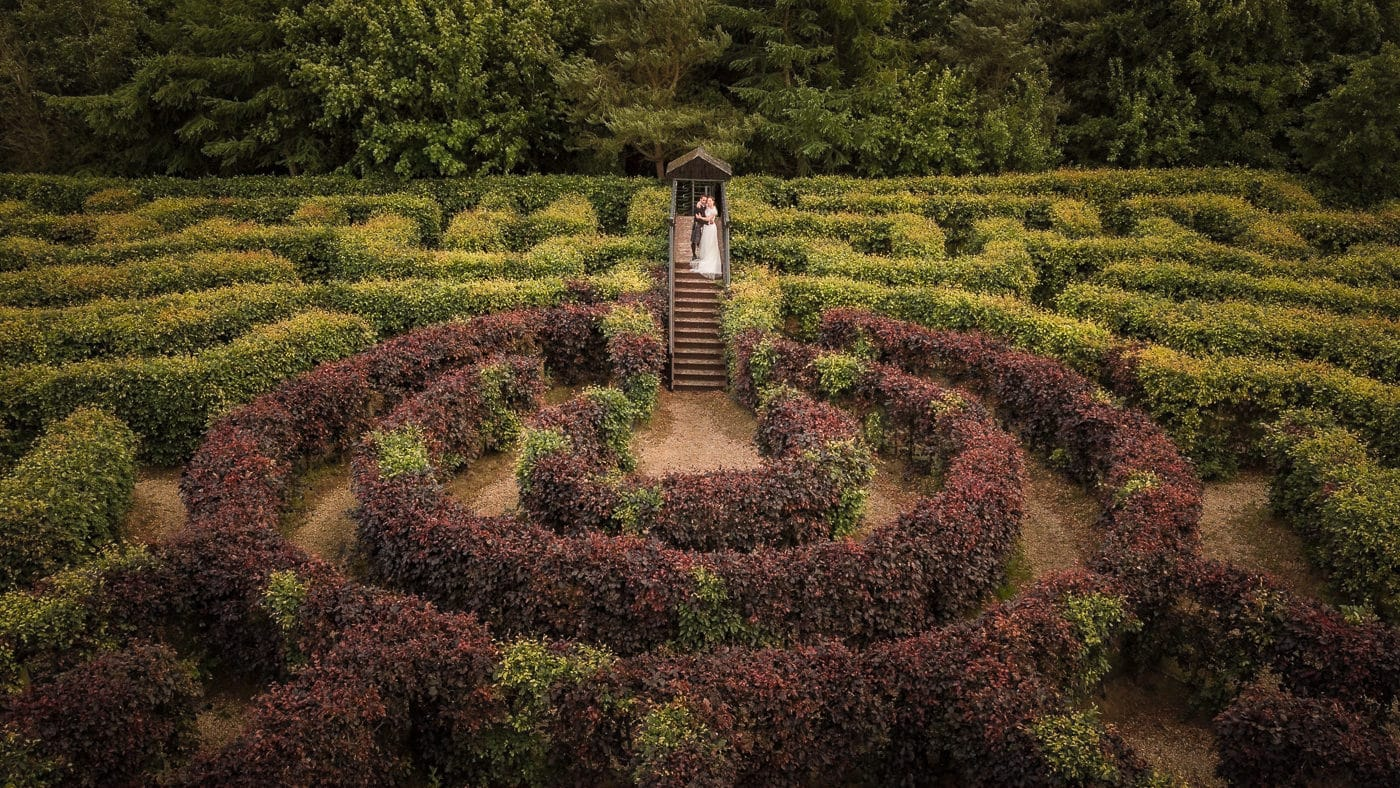 The bride and groom in the maze of the forbes of Kingennie