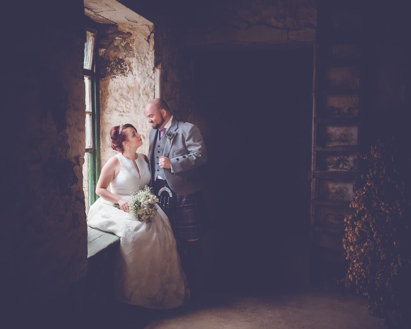 Artistic portrait of the bride and groom in one of the Pratis farm's barns