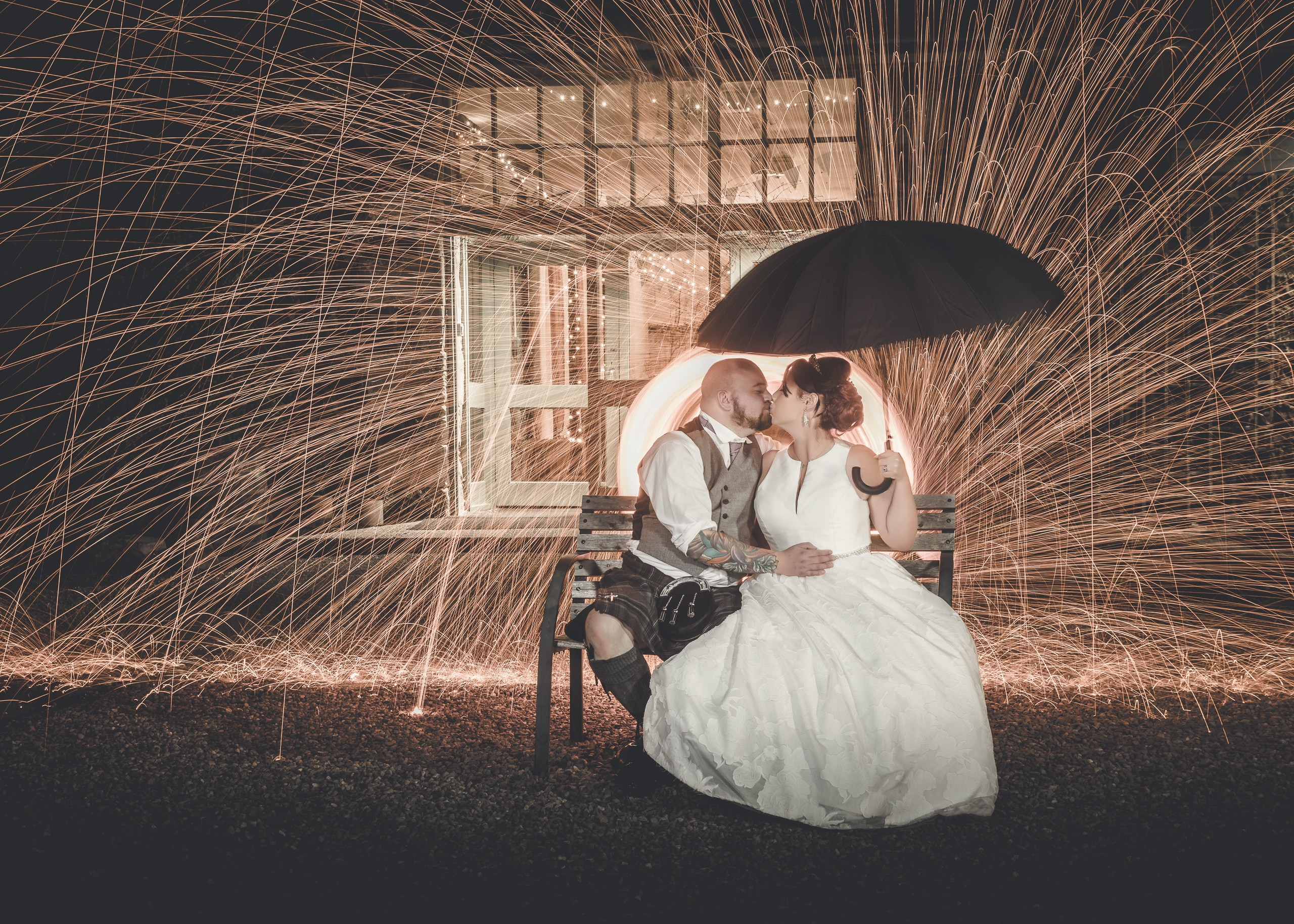 Artistic portrait of a bride and groom with steel wool fire