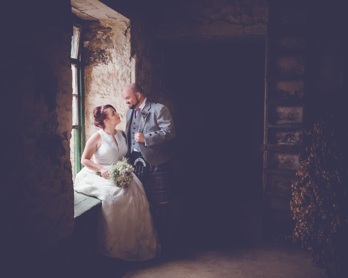 Bride and groom in a barn at the Pratis Farm near Leven Scotland