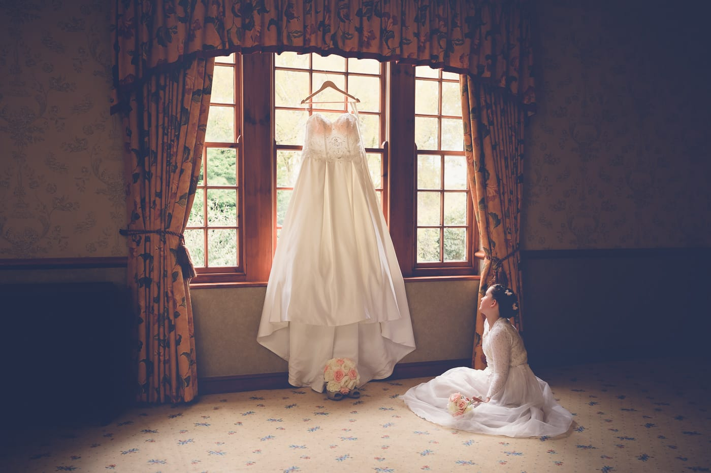 Young girl looking at the bridal dress